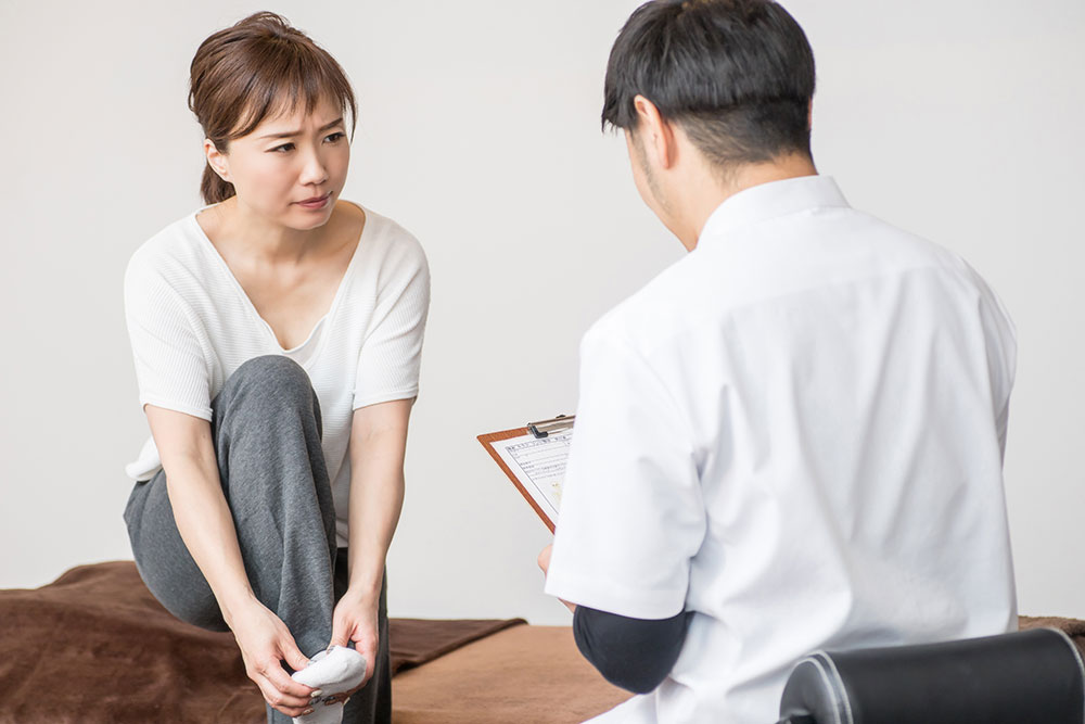 Woman consulting with doctor about a bunion